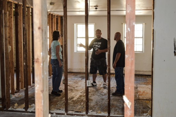 Scatterday, Burress, and DeCrease discuss the plans for the apartments above each of the storefronts.