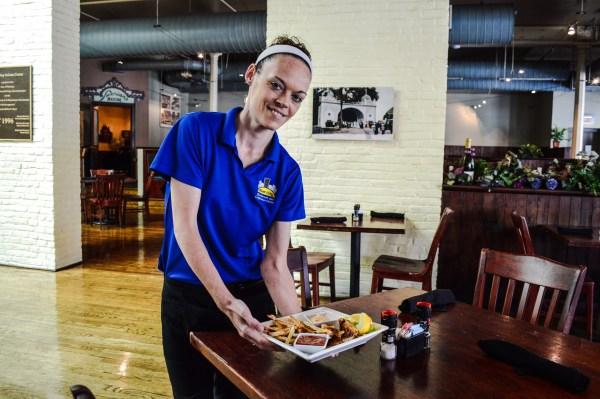 "Server Moriah Katz presents the ""catch of the day"" - Cajun Grouper."
