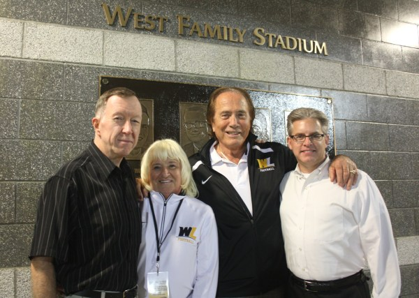 Dr. McCullough meets with Flip and Gary West, and Ron Witt following the dedication ceremony for the West Family Stadium.