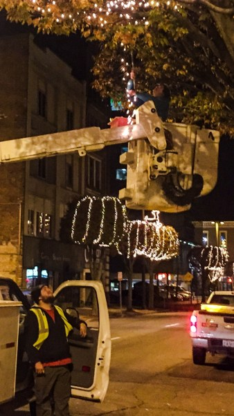 Crews with ERB Electric worked during the evening hours in downtown Wheeling the past two weeks to place lights on 81 trees along Main and Market streets.