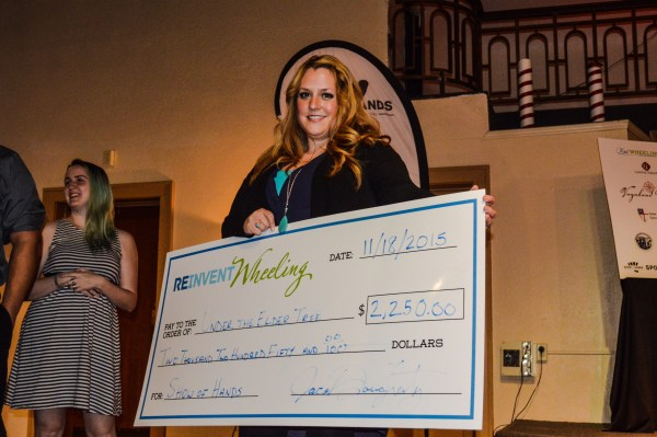 """Carrie Eller was presented the """"big check"""" Wednesday night at the Capitol Ballroom."""