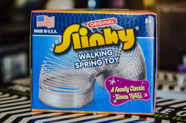It may just be a simple, precompressed helical spring, the Slinky has been walking down stairs since 1943.