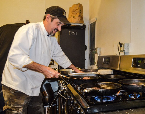 Employee Joe Cottage mans the stovetop at the Wheeling Brewing Company.