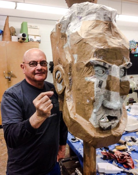 """Villamagna and several of his students at West Liberty University created """"big heads"""" for an entry in the Perkin's Restaurant Fantasy in Lights Parade a few years ago."""