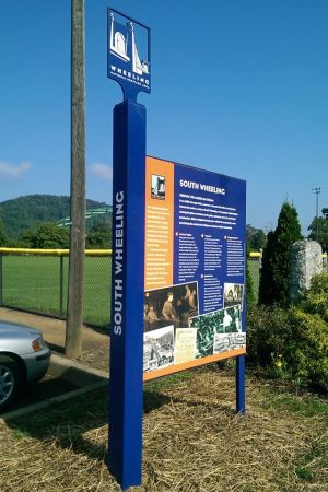 Interpretive signage created by Wheeling National Heritage Area tells neighborhood history of industry and labor.