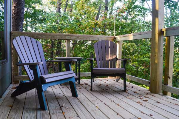Each of the new cabins offers a deck that sits among the trees at Grand Vue Park.