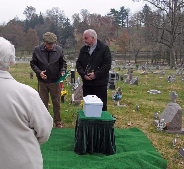 Jim Stultz speaks at the burial service for the OVMC skeletons.