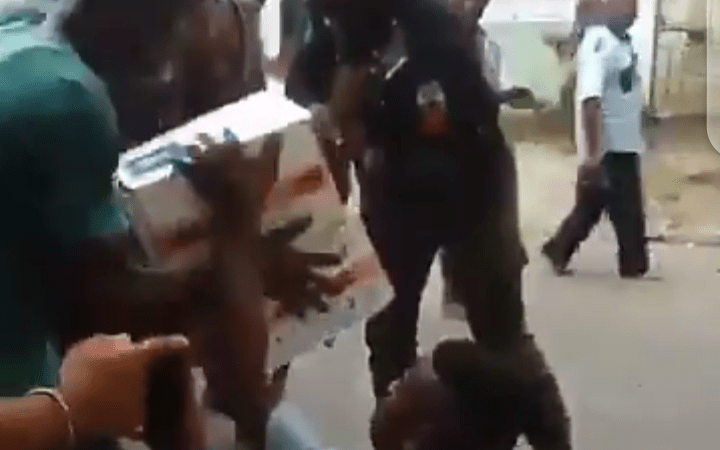 Watch Moment A Police Officer Carries COVID-19 Palliatives From Ayade Food Bank Warehouse And Gave To A Cripple In Calabar (VIDEO)