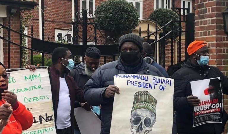 HAPPENING NOW!! [ Video]: Buhari's New Secret Hideout In London Unveiled As Protesters Take Over Location