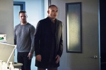 """Arrow -- """"Canary Cry"""" -- Image AR419a_0169b.jpg -- Pictured (L-R) Stephen Amell as Oliver Queen and Paul Blackthorne as Detective Quentin Lance -- Photo: Dean Buscher/The CW -- © 2016 The CW Network, LLC. All Rights Reserved."""