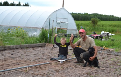Dene and Eric working at We Grow