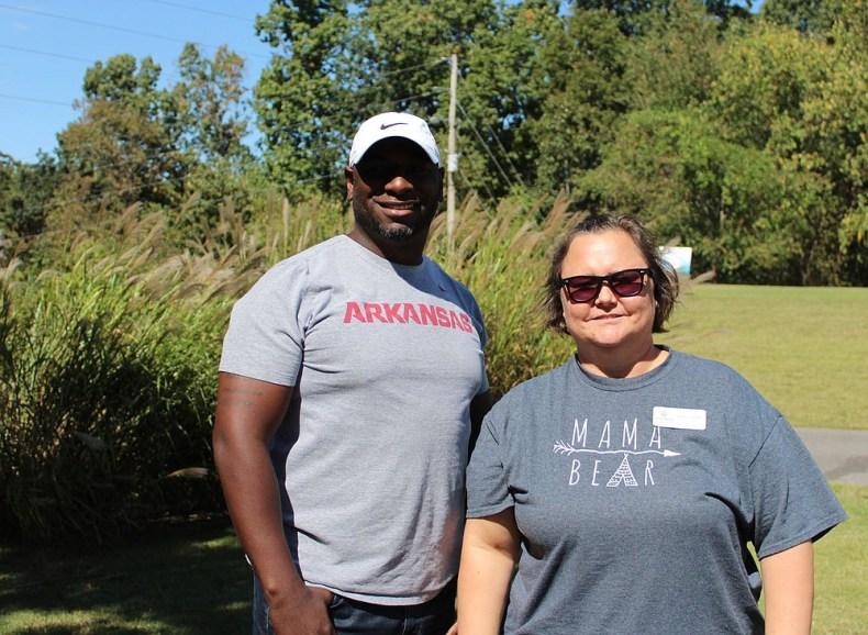 Travis Robinson and Mary Chambers help out at the Havenwood golf tournament Oct.1 in Bella Vista.  (NWA Democrat-Gazette/Carin Schoppmeyer)