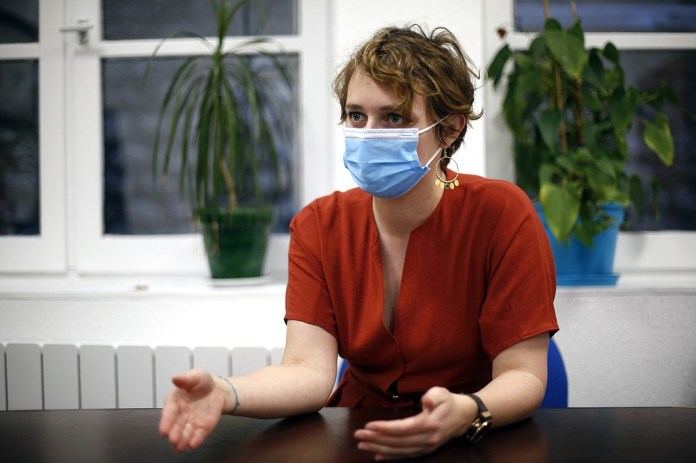 A retirement home director, Eve Guillaume, gestures during an interview in Paris, Wednesday, January 7, 2021. Guillaume says that obtaining the consent for vaccination of his 64 residents, or their guardians and families when they aren't fit enough to get along, proving by far the most labor-intensive part of her preparations to start vaccinations later in January.  (AP Photo / Thibault Camus)