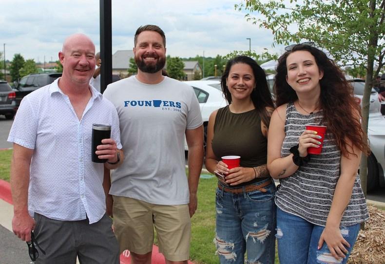 Troy Griffin, Shane Hevelone, Jasmin Beauchamp and Brittany Chase attend the Crawfish Boil.  (NWA Democrat-Gazette/Carin Schoppmeyer)