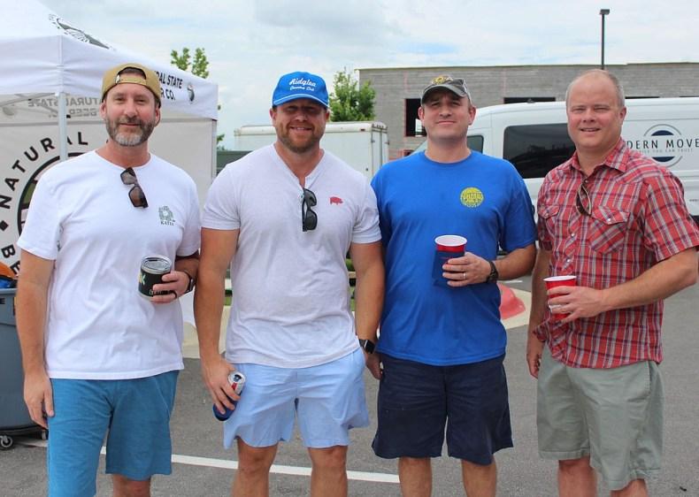 Chad Fisher (from left), Darrell Lindabury, John Mullins and David Erstine visit at the CSC fundraiser. (NWA Democrat-Gazette/Carin Schoppmeyer)