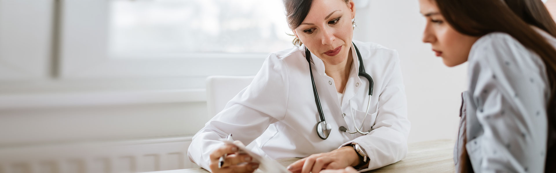 female doctor consulting with patient