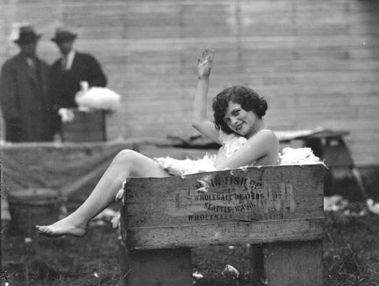 Naked girl a box of rabbit fur, 1920s