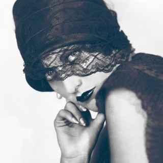 Joan Crawford looking veiled and edgy, 1930