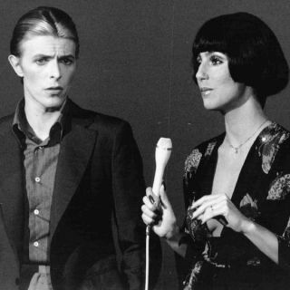 David Bowie and Cher looking like dolls, 1970s
