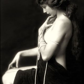 Ziegfeld girl draped in pearls