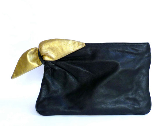 Black Leather Clutch Bag With Gold Bow Detail