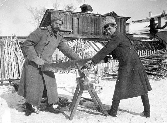 This photo of Tsarevich Alexei Nikolaevich and Tsar Nicholas II sawing wood at Tobolsk in 1917