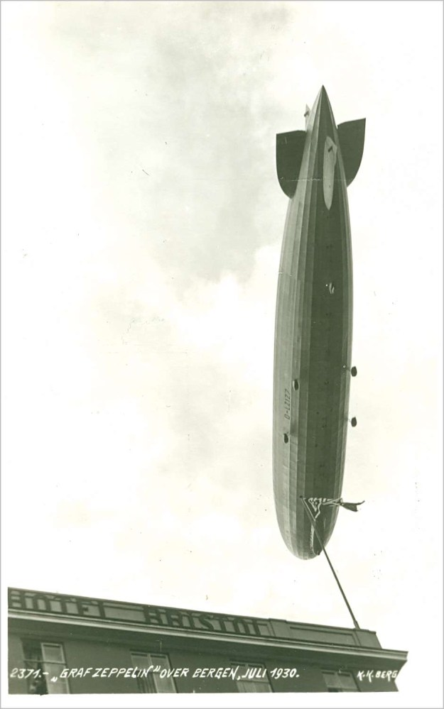 Airship passing over a hotel