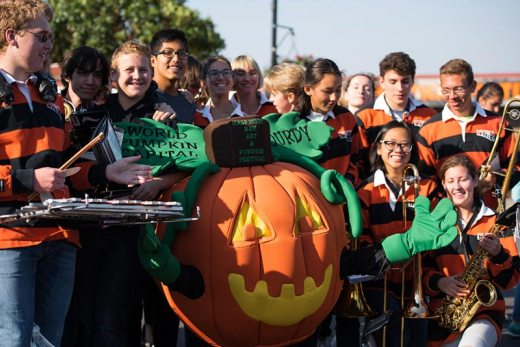 Pumpkin Festival mascot Gourdy with Half Moon Bay High School Band
