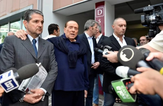 Italian tycoon and former prime minister Silvio Berlusconi talks with reporters as he leaves the hospital after a heart surgery in Milan, Italy July 5, 2016. REUTERS/Flavio Lo Scalzo