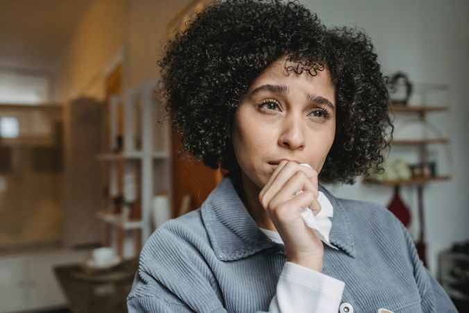 Woman almost crying while making negative thoughts