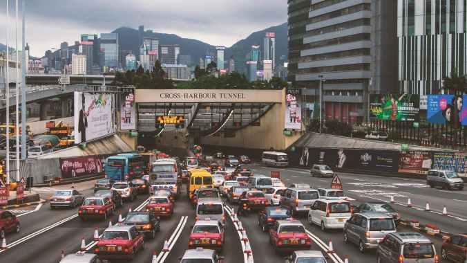 cars stuck in traffic jam in city road