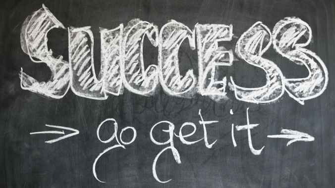 Success text written in blackboard - No need to strive for perfection