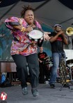 Several familiar faces in the New Orleans music scene performing a rollicking set of music at the 2011 Jazzfest. Lady Tambourine (left), Kevin O'day (center), and Big Sam (right) - Photo by Captain Brian Epstein