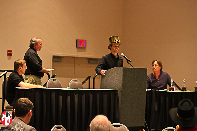 Mateusz Kaluzny of Q Workshop in the winner's circle at Origins 2013