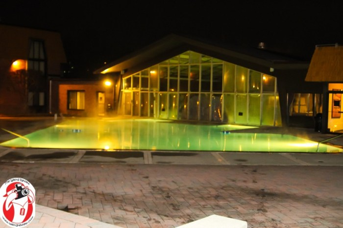 The outdoor portion of the indoor/outdoor pool at night