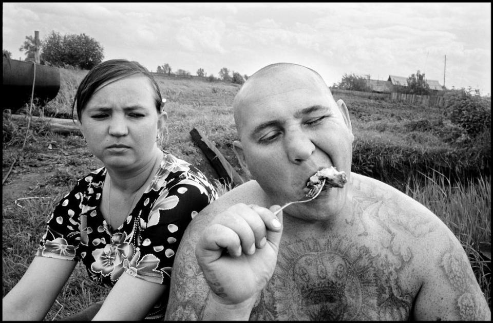 "RUSSIA. 70 kilometers from Yekaterinenburg. 2010. Sergey POLOVTEV, aka ""Kaban"" (wild boar), and his wife."