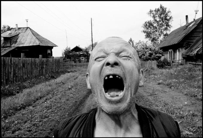 "RUSSIA. 70 kilometers from Yekaterinenburg. 2010. Vasily NOBOSYELOV aka ""Ded"" (grandfather)."