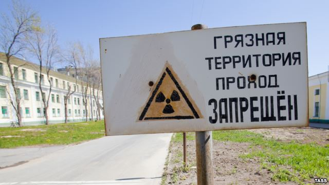 "Sign at Ozersk reads ""Contaminated zone. Entrance is prohibited"" Image via svoboda.org"