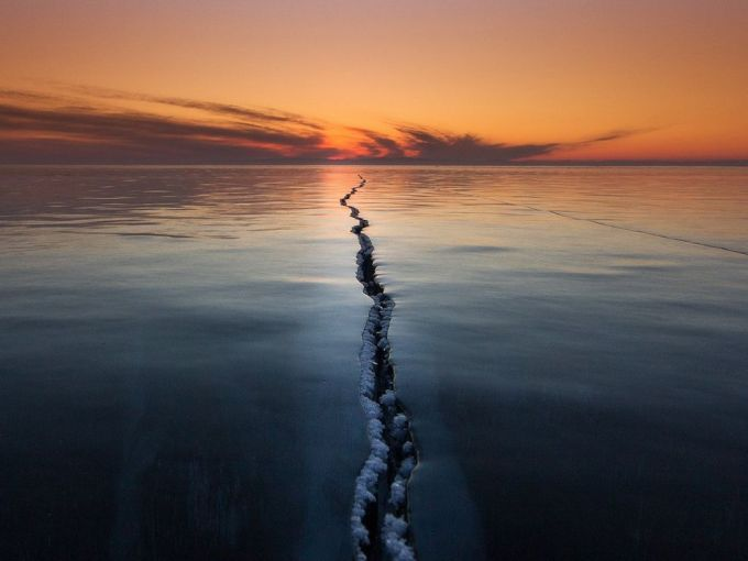 """Ice on Lake Baikal is a very interesting phenomenon. Ice ridges, cracks, tears, hugging. All this creates unique and fantastic stories."" A simple, yet otherworldly shot of Lake Baikal Photo by Alexey Trofimov."