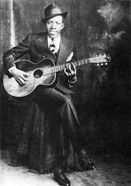 Robert Johnson et sa guitare en 1935