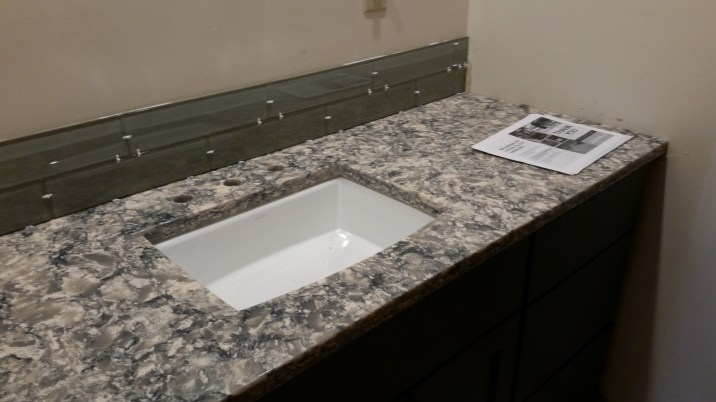 Countertop ready - waiting for medicine cabinet, towel bars, etc. Probably after painting.