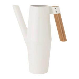 IKEA Bittergurka minimalist watering can. It's tall and white with a bamboo handle