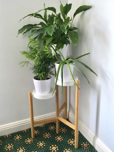 IKEA Satsumas minimalist plant stand and plant pots in a corner of a home.