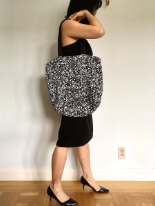 Baggu tote bag in a black and white print, as shown carried on the shoulder.