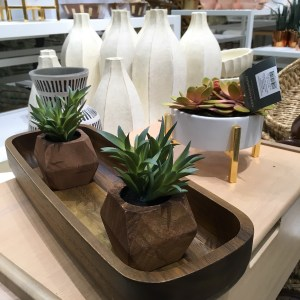 Target fake succulent plant arrangement in wooden pots.