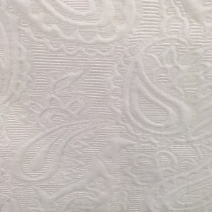 Victoria Beckham for Target review. Detail of white embossed fabric on girls' dress.