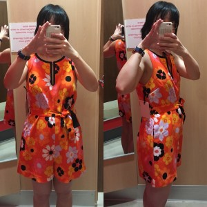 Victoria Beckham for Target fitting room photos of retro floral crepe romper. The romper is orange with a '60s-like floral pattern and it doesn't look that good on me.