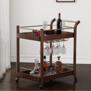Overstock wood bar cart shown with wine glasses.