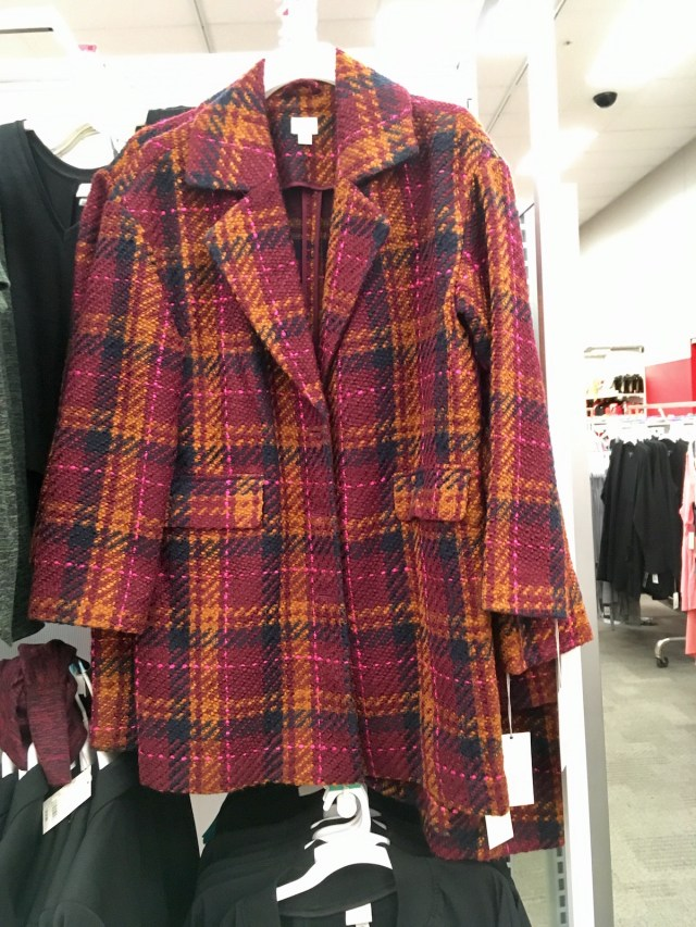Orange and pink plaid long jacket hanging from a hanger at Target