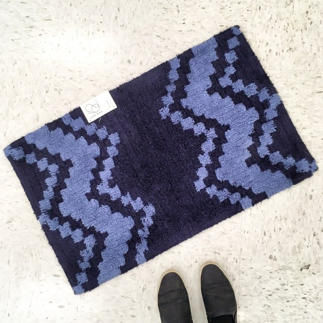 Navy and blue patterned bath mat.